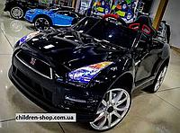 Детский электромобиль Nissan черный, фото 1