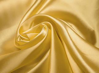 Ткань атлас золото