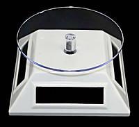 Вращающаяся подставка на солнечных батареях.10 см ширина. Диаметр круга: 9 см. Высота: 4,5 см.