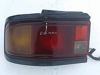 Фонарь стоп задний левый Mazda 323 BG 1988 - 1994 г.в. седан