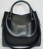 Женская сумка с металлическими ручками черного цвета