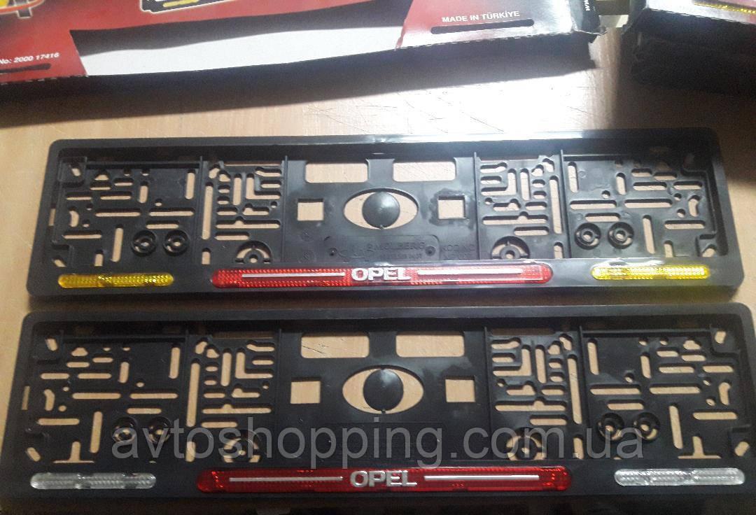 Рамка под номер с отражателями (катафотами) с металлической надписью Opel (Опель) , Мольберг, Рамка Черная