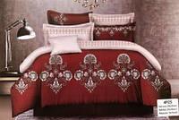 Красивый комплект постельного белья бордового цвета с ярким узором