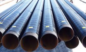 Трубы в битумной гидроизоляции лентой ДТЛ