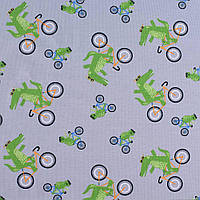 Трикотаж ( трикотажная ткань ) Darling хлопок с эластаном серый в крокодилы на велосипеде ш.150, итальянская т