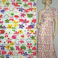 Трикотаж белый с рюшами и разноцвет. цветами ш.150
