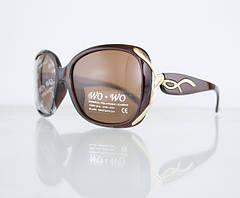 Женские солнцезащитные очки с поляризационным покрытием.