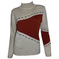 Вязаный женский свитер с асимметричными принтами.
