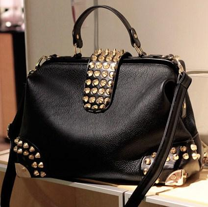 8842bd854631 Женская сумка саквояж с заклепками черная - PrettyLady.com.ua в Каменском