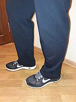 Брюки Nike трикотажные синие прямые