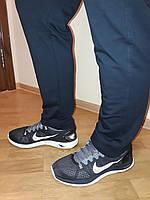 Брюки Nike трикотажные синие зауженные прямые