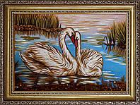 Лебеді з бурштину