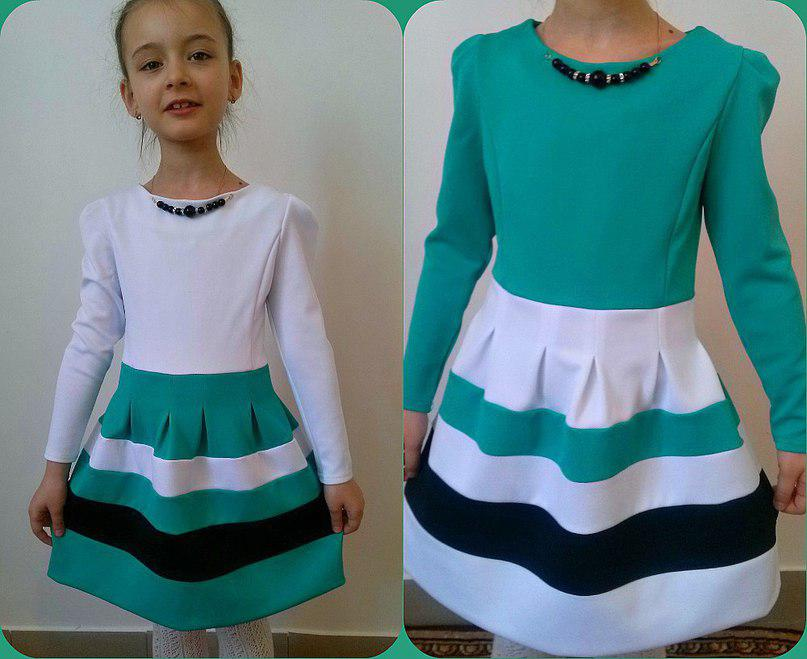 Платье  красивое на девочку до 134см.
