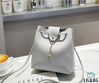 Элегантная маленькая женская сумка серого цвета