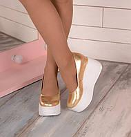 Золотые кожаные туфли на платформе