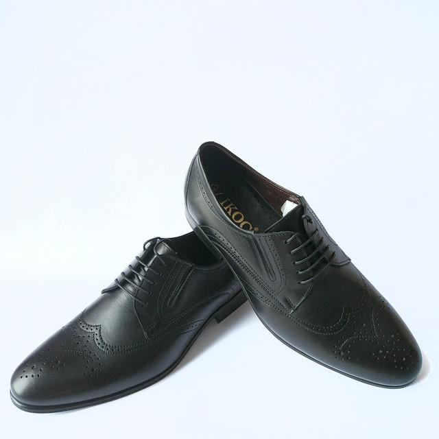 Обувь Ikos черного цвета кожаные в стиле броги на шнуровке