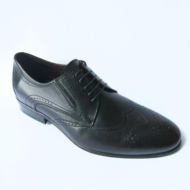 Обувь Ikos в стиле  броги на шнуровке черного цвета кожаные