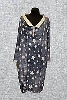 Женское платье украшено карманами