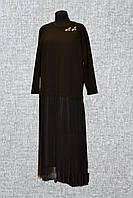 Женское платье украшенное юбкой с сетки