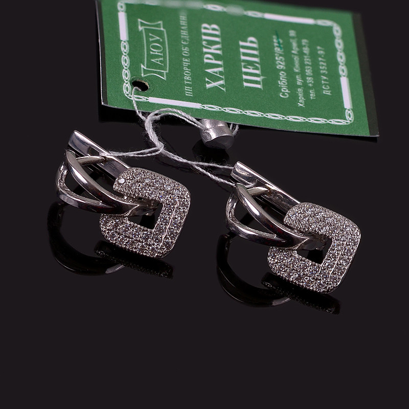 Серебряные родированные серьги с цирконами