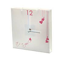 Настенные часы в виде бумажного пакета It is a girl Розовые