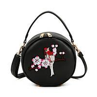 Круглая черная сумочка Птица