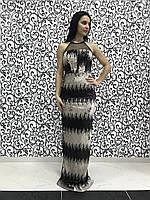 Женское вечернее платье в золотисто-черные паетки.