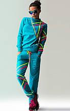 Голубой спортивный костюм с манжетами