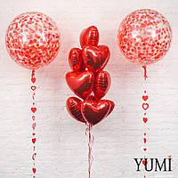 Композиция из 2 прозрачных шаров-гигантов с конфетти сердечки и гирляндами, связки из 10 красных фольгированных сердец