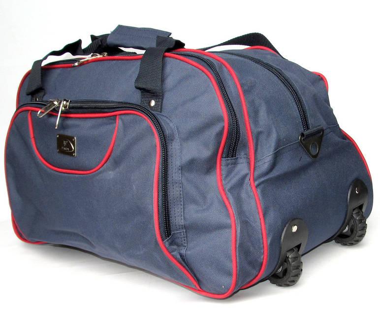 9a55f263a85c За счет этого, даже при сильной заполненности дорожной сумки, ее удобно  везти по любому напольному покрытию.