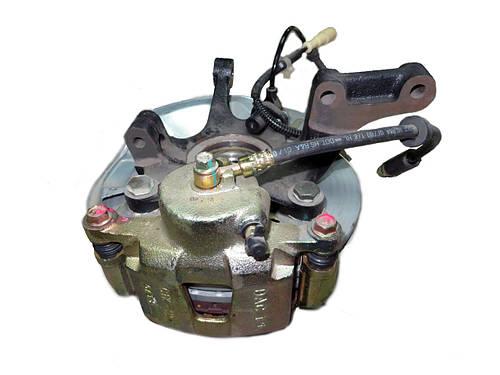 Кулак поворотный Nubira / Нубира левый в сборе (суппорт+диск) GM