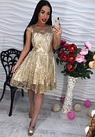 Обворожительное, женское платье с пышной юбкой из органзы украшено аппликацией из страз