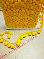 Тесьма с помпонами желтая 2 см.