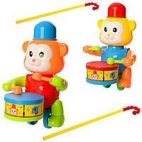 Каталка 0353 (72шт) на палке40см,обезьянка22см,стучит в барабан,2цвета,в кульке,22-18-12см