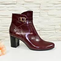Женские кожаные бордовые ботинки на невысоком каблуке