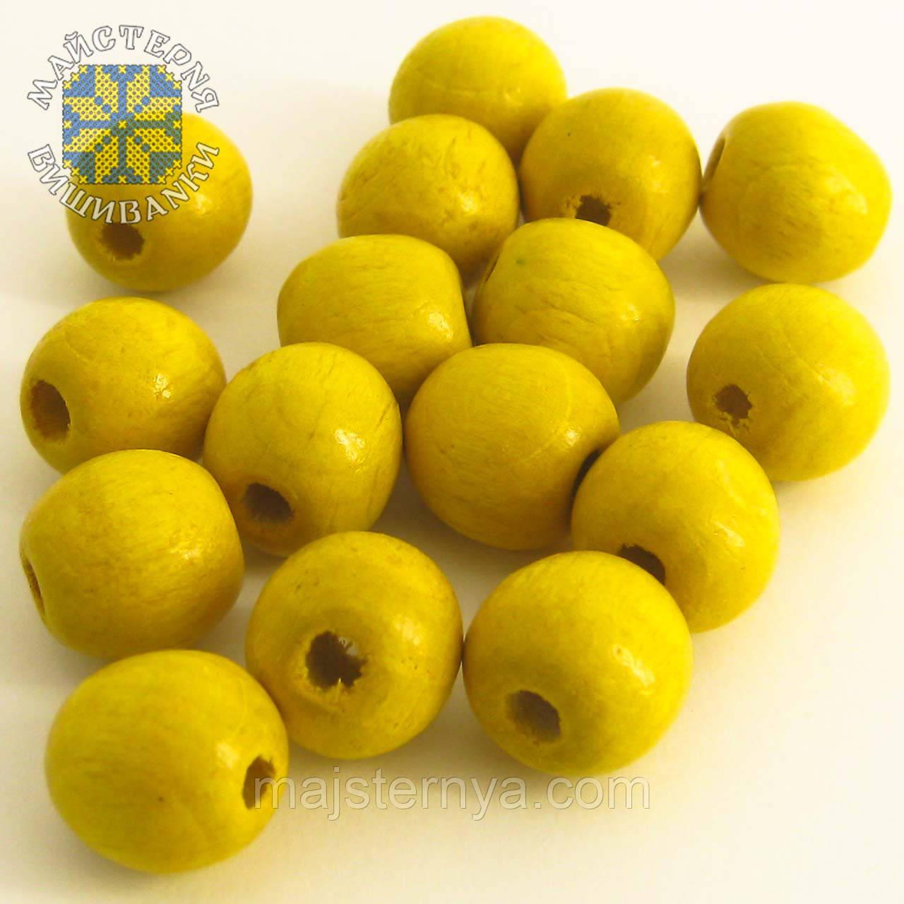 Бусини 1,3см жовтого кольору