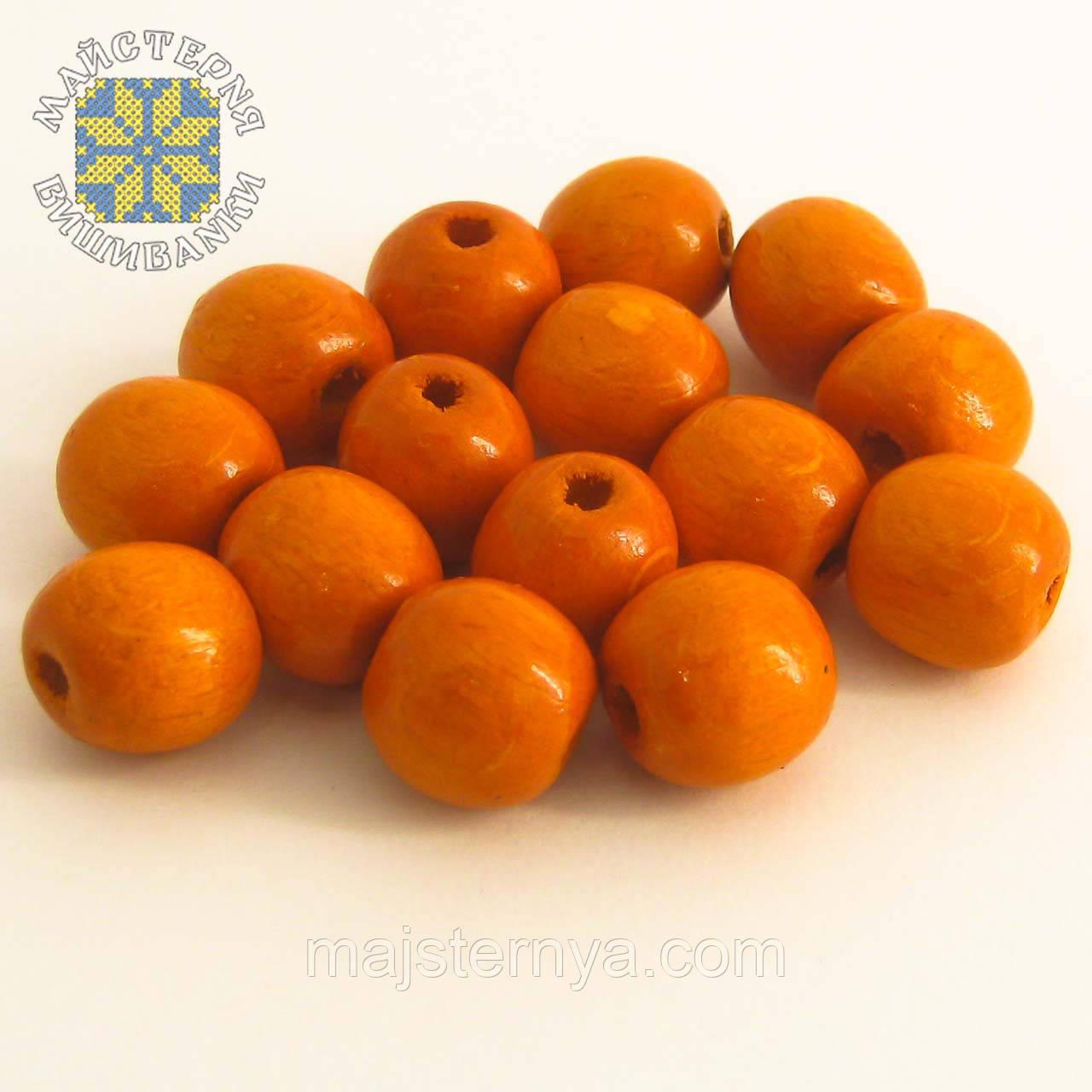 Дерев'яні бусини 1,3см помаранчевого кольору