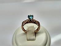 Роскошное золотое кольцо с крупным голубым камнем