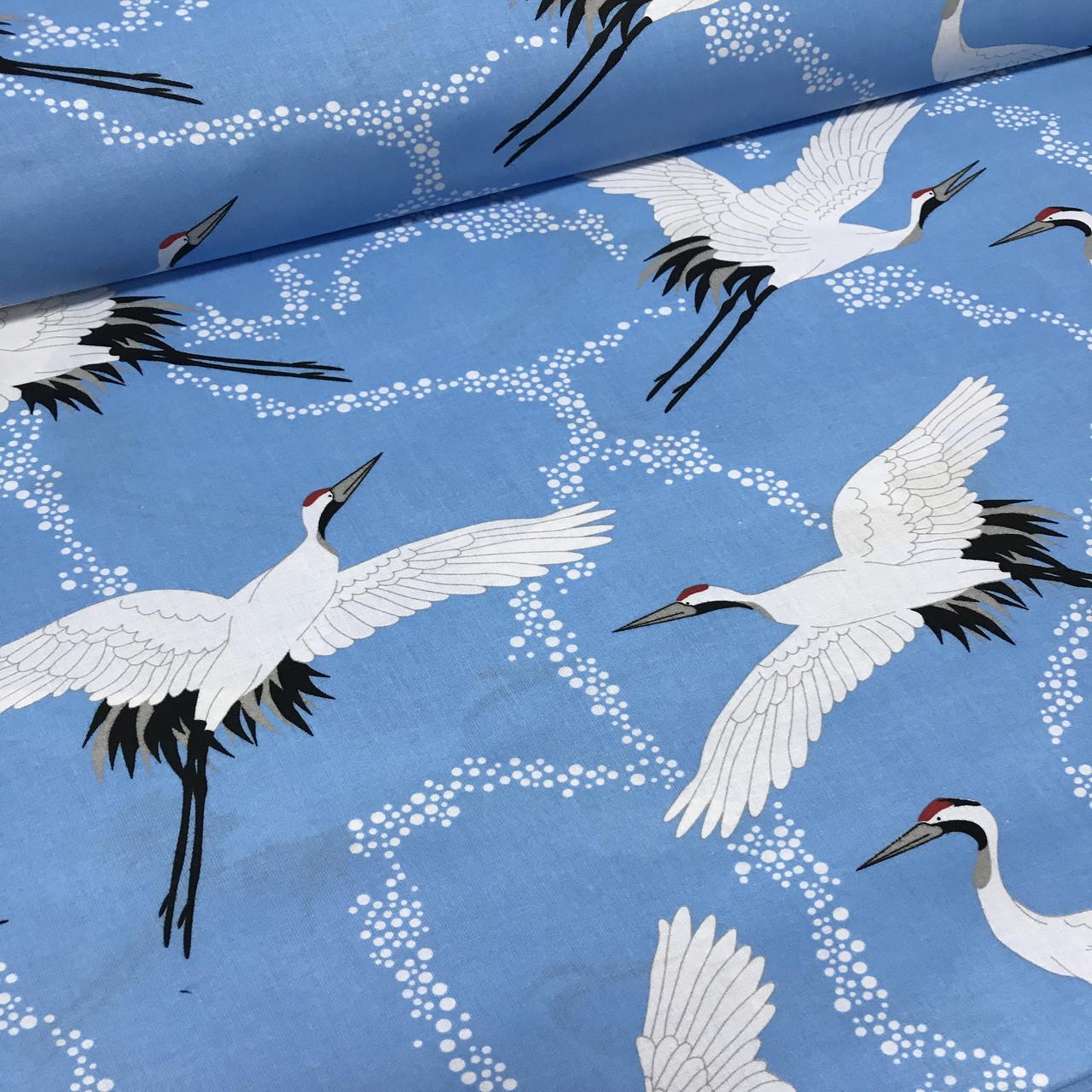 Бавовняна тканина польська лелеки на блакитному №116