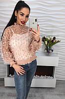 Элегантная женская блузка декорирована ленточками