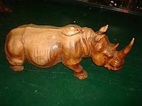 Носорог деревянный резной