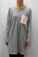 Трикотажное платье свободного кроя с карманом