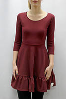 Платье с воланом по низу юбкиКороткое платье с широким воланом по низу юбки и рукавом три четверти темно-бирюз