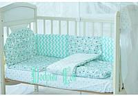 Комплект в кроватку для новорожденны