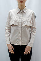 Женская бежевая рубашка в горох с воланами на груди