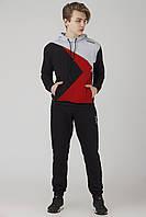 Трикотажный мужской спортивный костюм Reebok абстракция