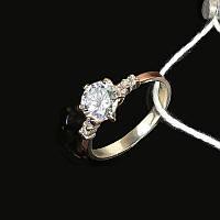 Серебряное кольцо с камнем и золотой вставкой