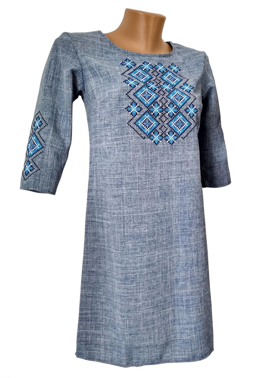Коротка жіноча вишита сукня у синьому кольорі із геометричним орнаментом