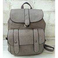 Рюкзак-сумка из эко-кожи коричневого цвета