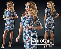 Трикотажное платье в цветочный принт.